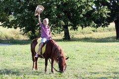 Boy riding pony horse Stock Image