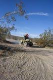 Boy Riding Quad. A boy riding a quad in the desert Stock Photography