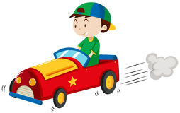 Boy riding red car Royalty Free Stock Photo
