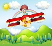 A boy riding in a red plane Royalty Free Stock Photo