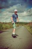 Boy riding on the road waveborde Stock Image