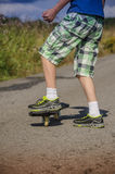 Boy riding on the road waveborde Royalty Free Stock Photography