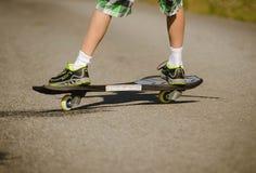 Boy riding on the road waveborde stock photo