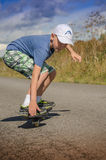 Boy riding on the road waveborde Stock Image