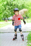 Boy is riding on rollers Royalty Free Stock Images