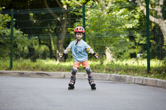 A boy is riding on rollers Royalty Free Stock Photography