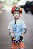 A boy is riding on rollers Stock Photo
