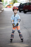 A boy is riding on rollers Royalty Free Stock Images