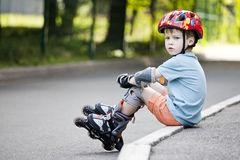 A boy is riding on rollers Stock Photos
