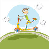 Boy riding scooter Stock Image