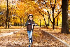 Boy riding scooter Royalty Free Stock Images