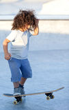 Boy riding a skateboard Royalty Free Stock Photos