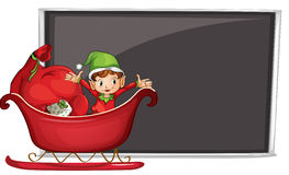 A boy riding in a sleigh with gifts Royalty Free Stock Photo