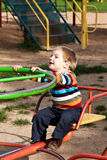 Boy riding on a swing Royalty Free Stock Photo