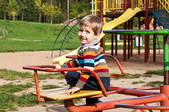 Boy riding on a swing Stock Photo