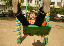 Boy riding on a swing Royalty Free Stock Photography