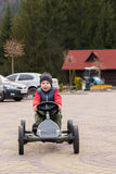 Boy riding a toy car Royalty Free Stock Photo