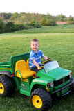 Boy on riding tractor Royalty Free Stock Photo
