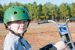 Boy riding trike royalty free stock photos