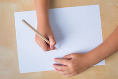 Boy right hand with pencil and left empty Stock Photos