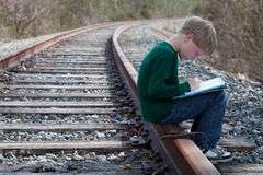 Boy on the right track Royalty Free Stock Images