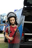 Boy with antiriot equipment Royalty Free Stock Images
