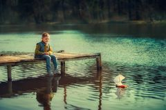 Boy on the river royalty free stock photos