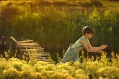 BOY by the river Stock Photography