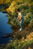 BOY by the river Royalty Free Stock Photos