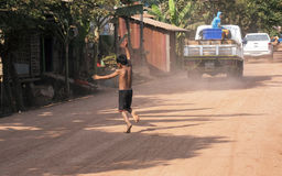 Boy on the road. In cambodian village Stock Images
