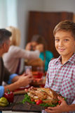 Boy with roasted meat Royalty Free Stock Image