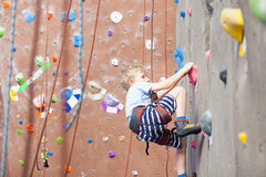 Boy rock climbing Royalty Free Stock Photography