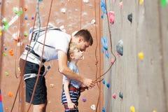 Boy rock climbing Stock Photography