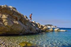 The boy on the rock. The boy on the rock in sea. Marathias beach, Zakynthos Island, Greece royalty free stock photography