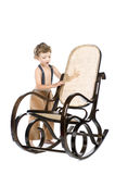 Boy and rocking chair Stock Image