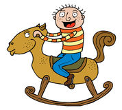 Boy & Rocking Horse. The boy is really exciting riding the wooden horse Stock Photos