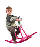 Boy on Rocking Horse. On white background Royalty Free Stock Image