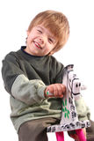 Boy on Rocking Horse Stock Photo