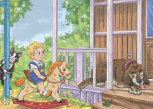 Boy on the rocking horse  with cat and dog in summer house Stock Photography