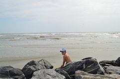 Boy on rocks at Hilton Head Island, South Carolina Stock Image