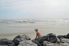 Boy on rocks at Hilton Head Island, South Carolina Stock Image