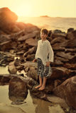 The boy on the rocks Stock Photography