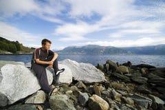 Boy on rocks near watrr Royalty Free Stock Images