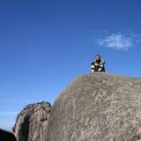 Boy on rocky mountain royalty free stock photo