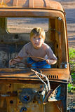 Boy in a role of the driver Royalty Free Stock Photos