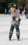 Boy in roller blades outdoors Stock Photo