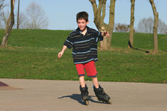 Boy Roller-Blading Stock Photos