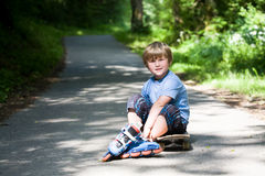 Boy on rollerblades Stock Photography