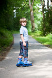 Boy on rollerblades Stock Images