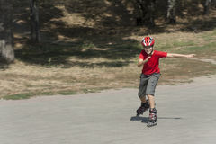 Boy on the rollerblades Royalty Free Stock Image